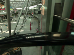 Dusseldorf airport terminal escalators smooth steady cam point of view pov Stock Footage