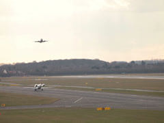 Lufthansa jet airplane taking off from dusk dusseldorf airport Stock Footage