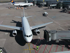 Airbridge docking to aegean jet airplane on dusseldorf airport Stock Footage