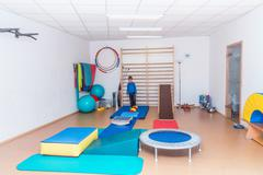 Child is therapeutic exercises in the gym Stock Photos