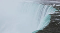 At the brink of the Horseshoe Falls in winter, Niagara Falls - stock footage