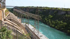 Power lines from water generating station at Niagara River, Canada - stock footage
