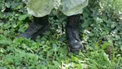 Military service man standing next to wired fence Stock Footage