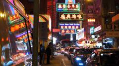 Hong Kong Kowloon Yau Ma Tei neon lights signs China Asia Stock Footage