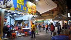 Hong Kong Yau Ma Tei Temple street night market food street China Asia Stock Footage