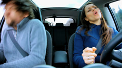 Couple in moving car dancing and singing like crazy Stock Footage