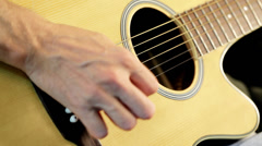 Guitar player playing acoustic guitar Stock Footage