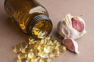 Stock Photo of garlic oil capsules, vitamins d pills