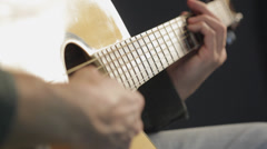 Guitarist playing electric acoustic guitar - stock footage
