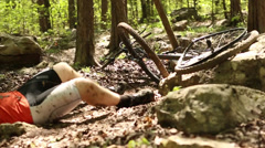 Mountain biker hurt in a bike wreck - stock footage
