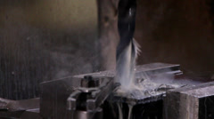 Heavy industry - Drilling using a oil based cutting fluid on the milling cutter. Stock Footage