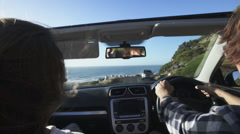 Couple driving convertible car cabriolet cape town south africa steadicam shot - stock footage