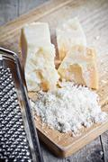 grated parmesan cheese and metal grater - stock photo