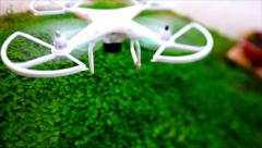 From the top shot of quadcopter flying on a green grass. Stock Footage
