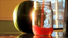 Beautiful and Healty Watermelon Juice Versed In a Jar at the End Of the Day Sun Stock Footage
