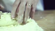 Stock Video Footage of Rule of thirds about man kneading flour and water to make pasta.