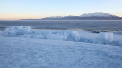 Utah lake frozen ice sheet dolly - stock footage