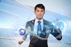 Serious businessman touching earth graphic Stock Illustration