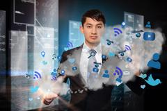 Serious businessman touching apps in cloud Stock Illustration