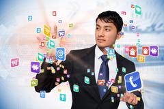 Stock Illustration of Asian businessman touching app interface