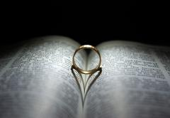 Wedding Ring and Bible Stock Photos