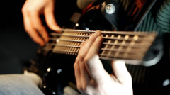 Bass guitar playing - zoom in Stock Footage