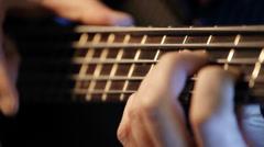 Bass guitar player practicing - closeup Stock Footage