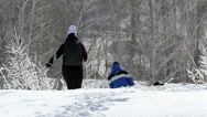 Stock Video Footage of Mother with children walking in snow drifts