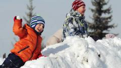Children playing in the snow Stock Footage