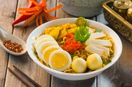 Stock Photo of hot and spicy singapore curry noodle with decoration setup