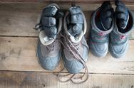 Stock Photo of adult snow boots alongside those of a child