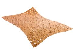 Whirling bamboo mat floating in the air Stock Photos