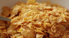 Corn flakes pouring - preparing breakfast Stock Footage
