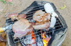 roasted pork and orinji mushroom on the grill - stock photo