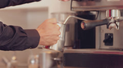 Barista steaming milk at the coffee machine Stock Footage