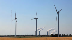 Wind turbines spinning - coal is burning Stock Footage