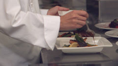 Chef pouring sauce over fish dish Stock Footage