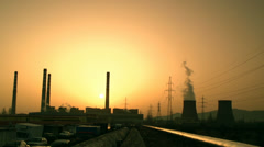 Factory with chimneys and electric poles in sunrise Stock Footage