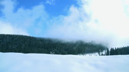 Stock Video Footage of Mountains in winter clouds moving quickly