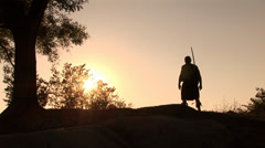 Thracian warrior with sword technique shows sunset Stock Footage