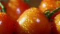 Water drops on tomatoes. Slider macro shot Footage