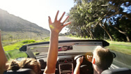 Stock Video Footage of Couple driving convertible car cabriolet cape town south africa steadicam shot