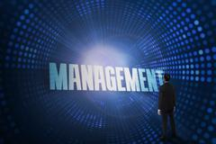 Management against futuristic dotted blue and black background Piirros