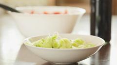 Preparing salad;  pouring dressing or sauce on leek; Stock Footage