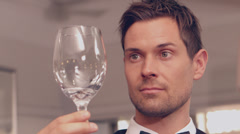 Waiter polishing wine glass Stock Footage