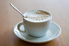 cup of coffee with crema - stock photo