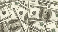 Hundred dollar bills as background. Money pile, financial theme Stock Footage