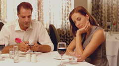 Woman being ignored on a date Stock Footage