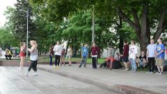 Modern street dancers perform show in street square Stock Footage