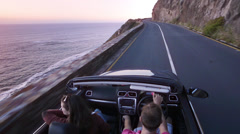 Couple driving convertible car cabriolet cape town south africa steadicam shot Stock Footage